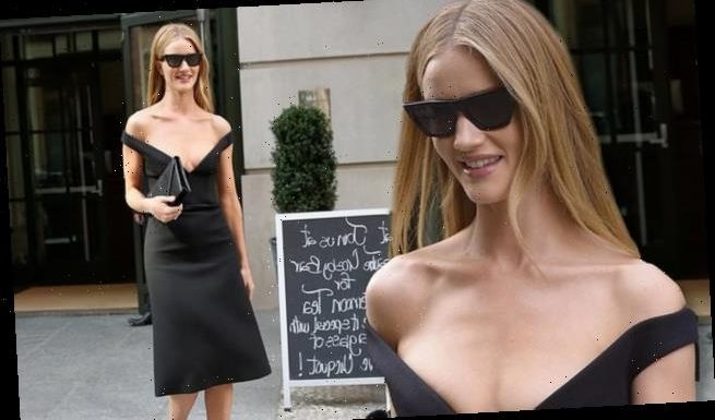 Rosie Huntington-Whiteley displays her cleavage in a plunging dress