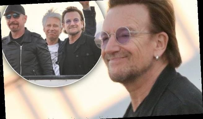 Bono and U2 step off a private jet in Brisbane on Joshua Tree Tour