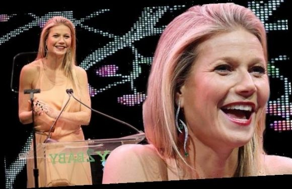 Gwyneth Paltrow flashes a smile while 'so ill' at the Baby2Baby Gala