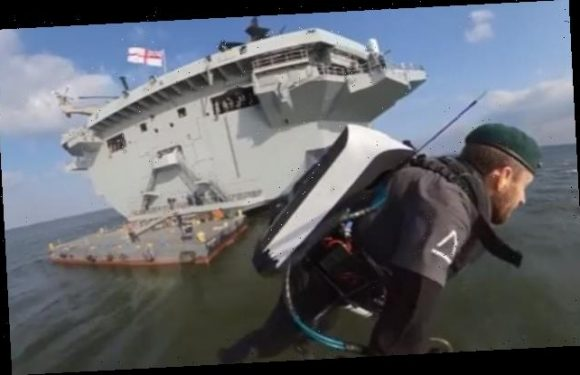 'Rocket man' wearing a jet pack launches from HMS Queen Elizabeth