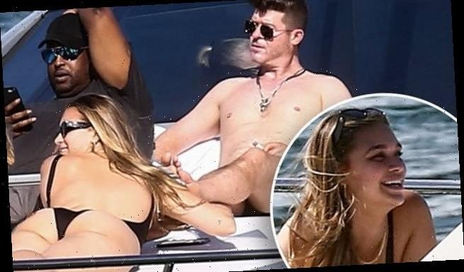 Robin Thicke enjoys a yacht trip in Miami with fiance April Love Geary