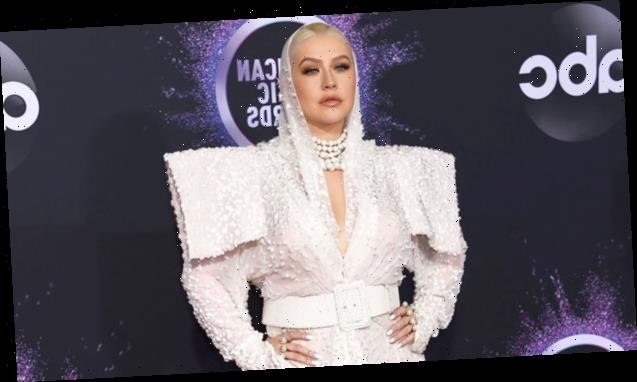Christina Aguilera Dazzles In A White Embellished Gown With Oversized Shoulders & A Hood At The AMAs
