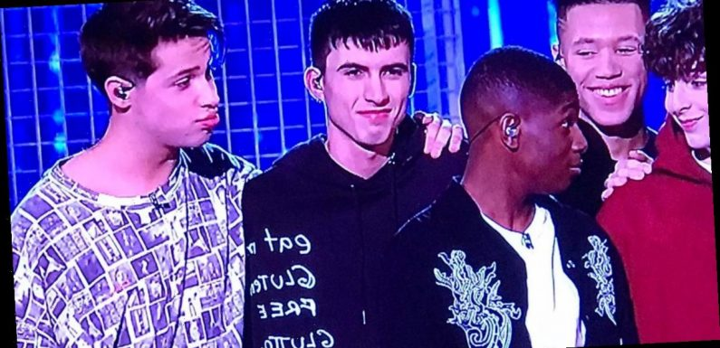 X Factor fans left baffled by boy band lad's 'rude' hoody during final