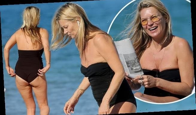 Kate Moss, 45, shows off her figure in a black strapless swimsuit