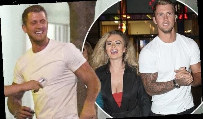 PICTURED: The moment grinning Dan Osborne entered 'threesome hotel'