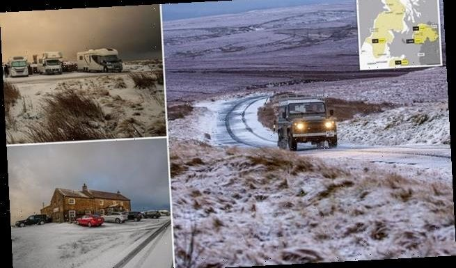 Heavy snow blankets parts of the UK
