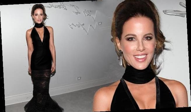 Kate Beckinsale turns heads in black dress with a plunging neckline