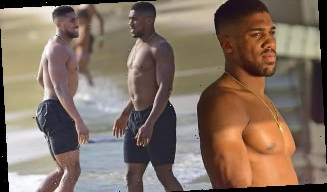 Anthony Joshua displays his ripped physique on the beach in Barbados