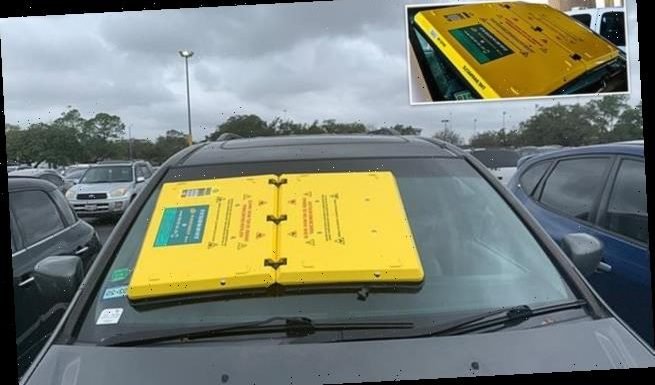 Barnacle clamped onto windshield for drivers with parking violations