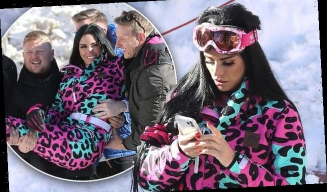Katie Price is carried by male fans during ski trip in the French Alps