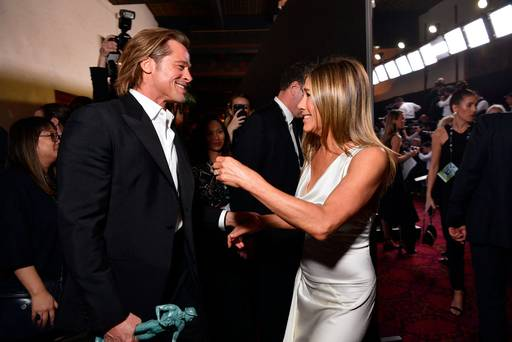 Brad Pitt is 'blissfully naive' to the fanfare around his SAG reunion with Jennifer Aniston