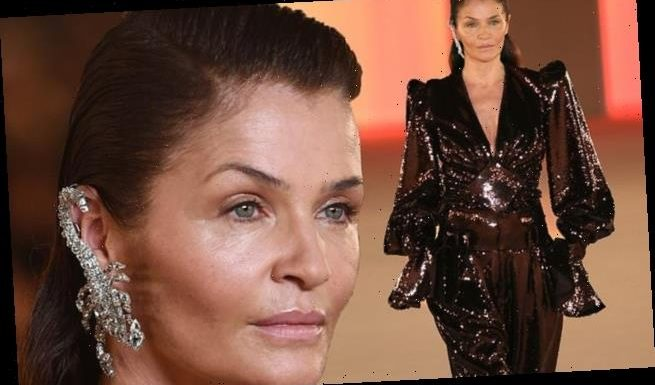 Helena Christensen, 51, oozes glamour in a plunging jumpsuit