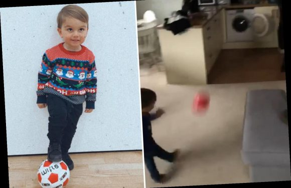 Football-obsessed toddler scores an amazing goal… in the washing machine