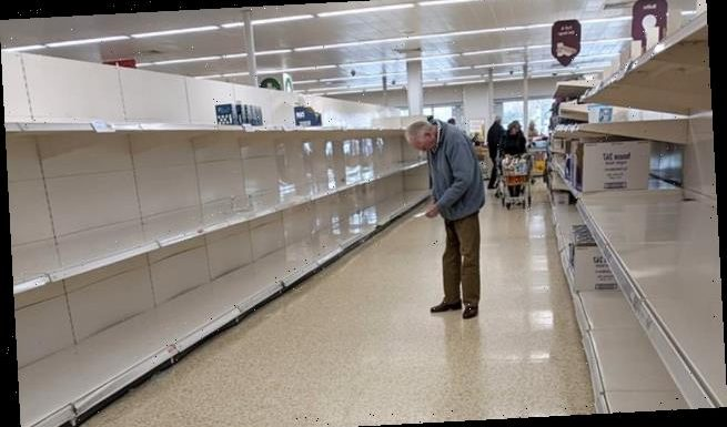 Heartbreaking photo of elderly man looking at empty shop shelves