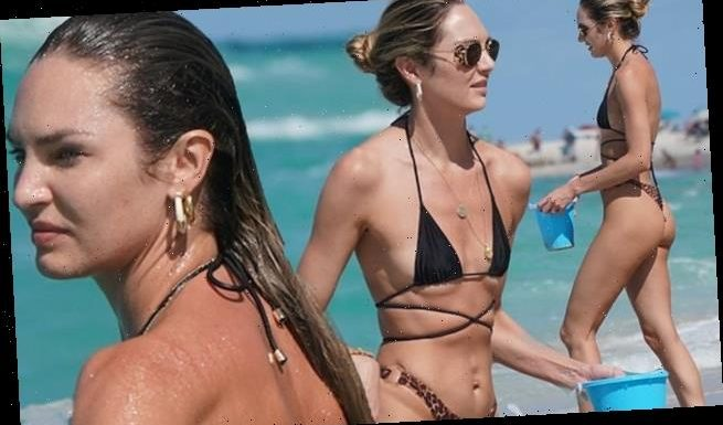 Candice Swanepoel sports a tiny bikini at the beach in Miami