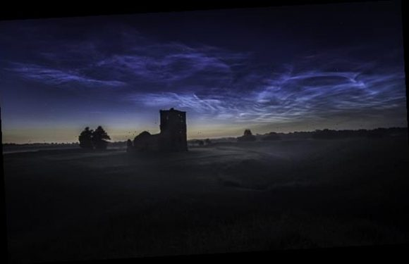 Rare 'night-shining' clouds give 12th century church 'a ghostly glow'