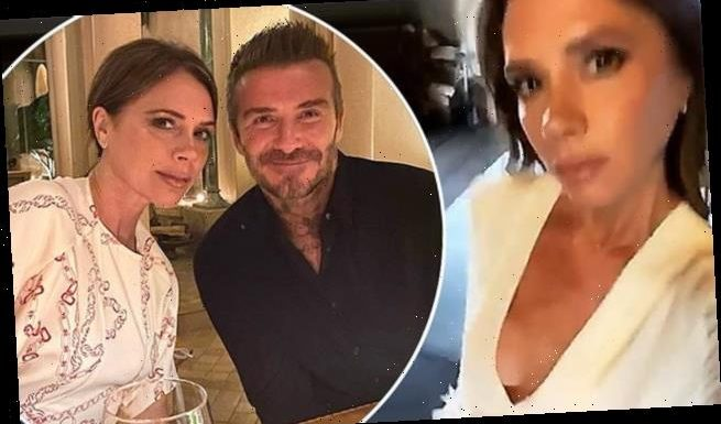 Victoria Beckham struts through the house in plunging blouse