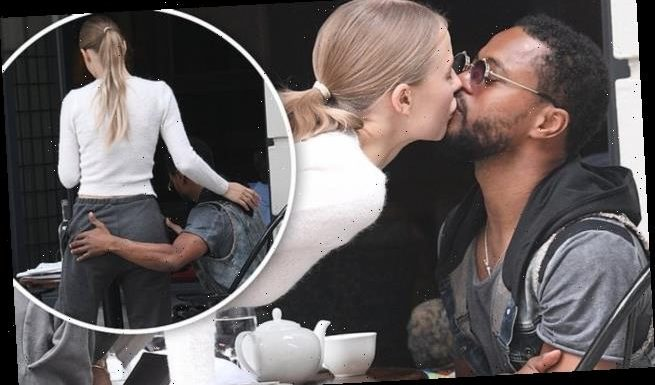 Married footballer Patrice Evra is pictured kissing mystery woman