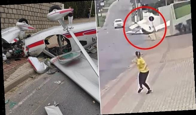 Small plane crashes in Brazil narrowly missing cars and a pedestrian