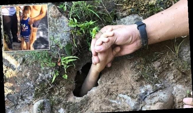 Rescuer saves a drowning boy by grabbing his hand through a tiny hole