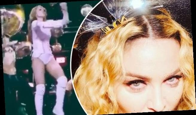 Madonna reveals she is STILL on crutches following her knee injury