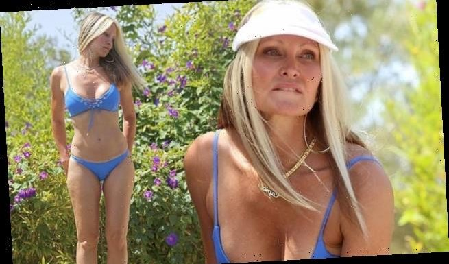 Caprice, 48, shows off her stunning figure in a blue bikini in Ibiza