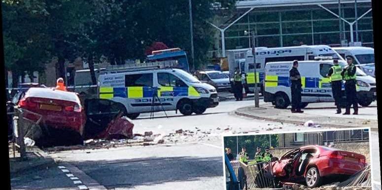 Two men in 20s killed during town centre police chase when BMW ploughed into barrier in Brighouse