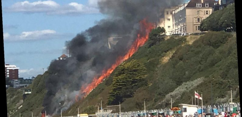 Bournemouth beach evacuated as huge fire rages after three beach huts go up in flames in front of horrified sunseekers