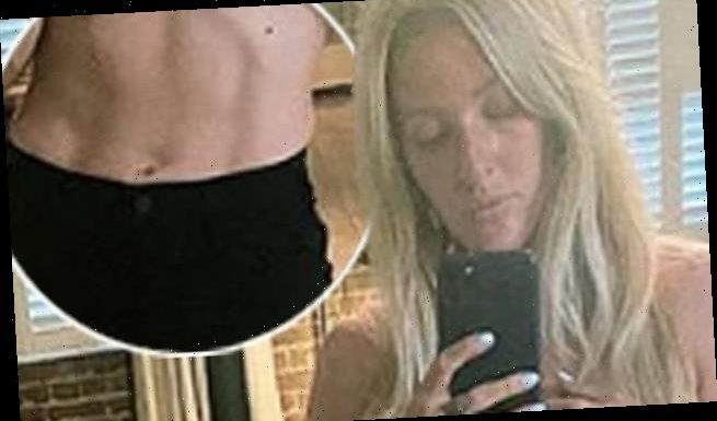 Ellie Goulding shows off her washboard abs as she poses topless