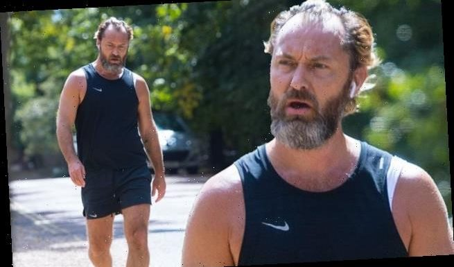 Jude Law showcases his rugged look during a low-key jog in London