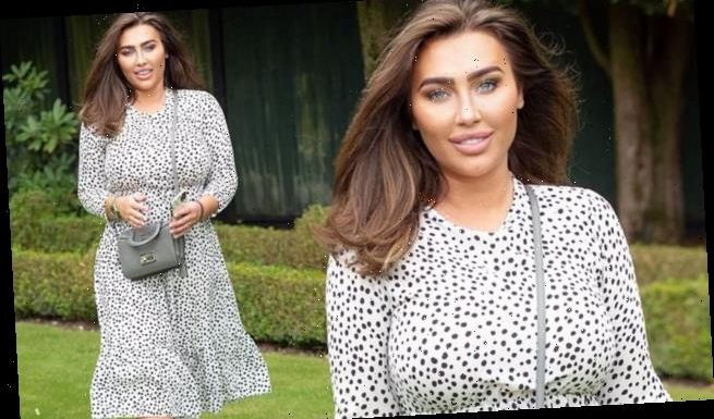 Lauren Goodger displays her demure side in a chic spotted dress