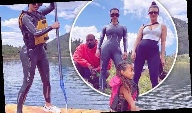 Kim joined by Kanye AND Kourtney as she takes North paddle-boarding