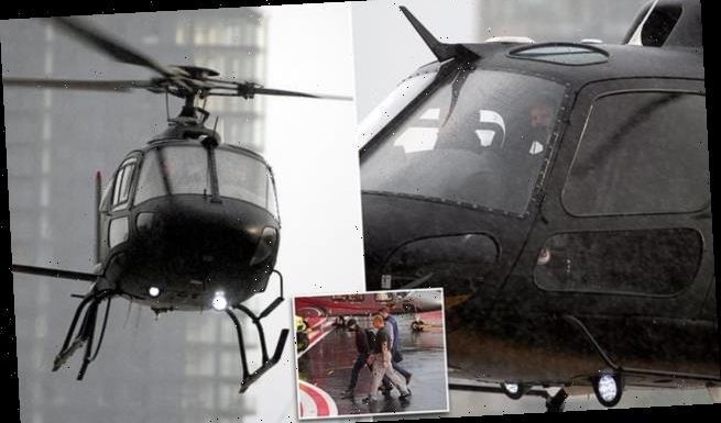 PICTURE EXCLUSIVE: Tom Cruise battles torrential rain in helicopter