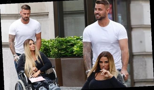 Katie Price is supported by her doting boyfriend Carl Woods