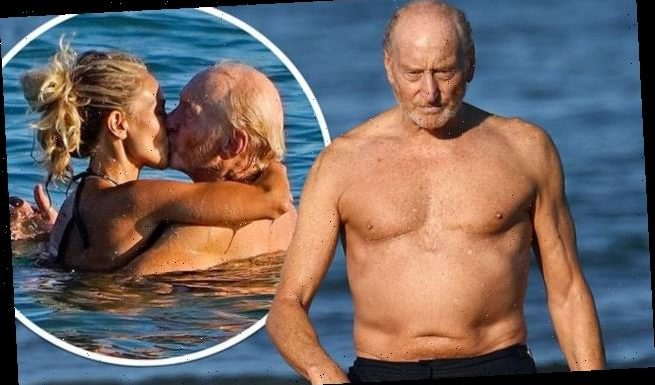 Charles Dance shares a kiss with a younger female companion in Venice