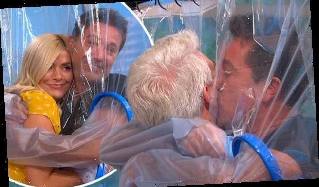 Gino D'Acampo showers Phillip Schofield in kisses through a sheet