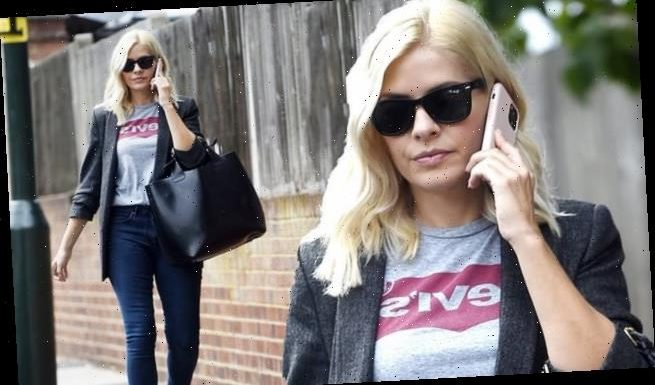 Holly Willoughby looks casual in dark grey jacket and Levi's t-shirt
