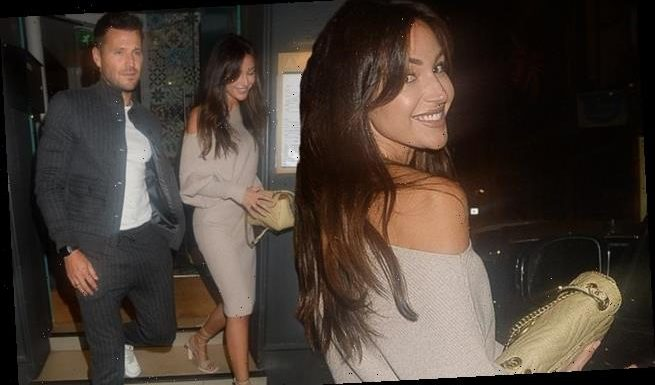 Michelle Keegan displays her phenomenal figure in a beige knit dress