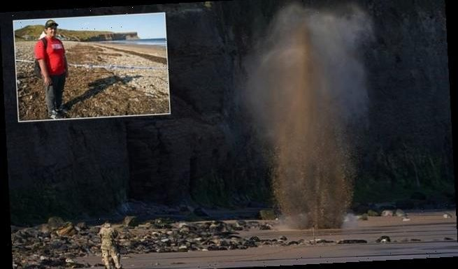 Dramatic moment soldiers detonate a hand grenade found on a beach