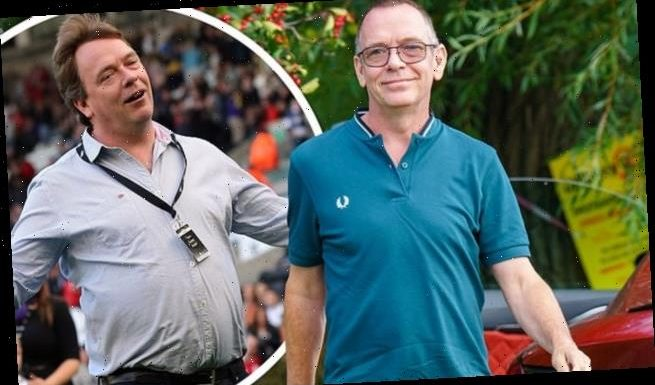 Adam Woodyatt shows off his slimmed-down frame following weight loss