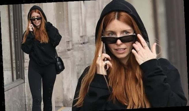 Stacey Dooley cuts a casual figure in a black hoodie and leggings
