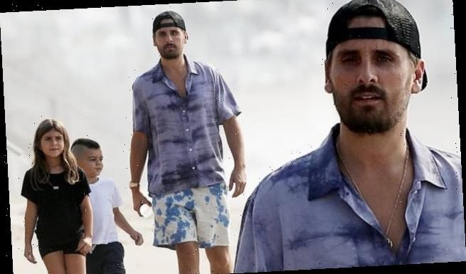 Scott Disick enjoys a day at the beach with two of his kids
