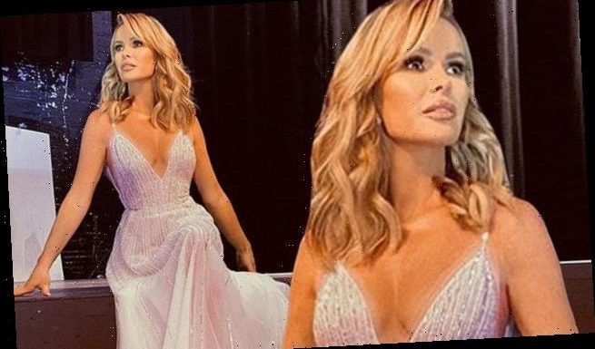 Amanda Holden puts on a defiant display in plunging metallic ballgown