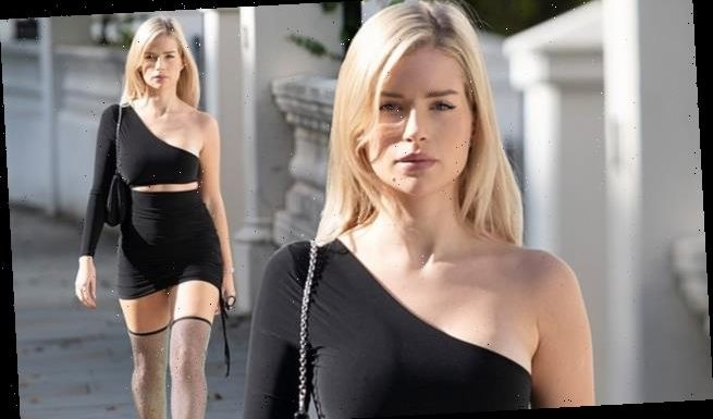 Lottie Moss flaunts her model figure in black cut out dress in London