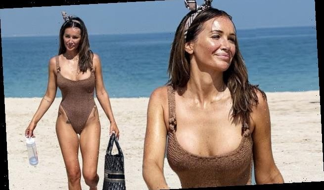 Laura Anderson shows off her tanned curves in racy brown swimsuit
