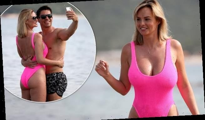 Rhian Sugden flaunts her eye-popping curves in hot pink swimsuit