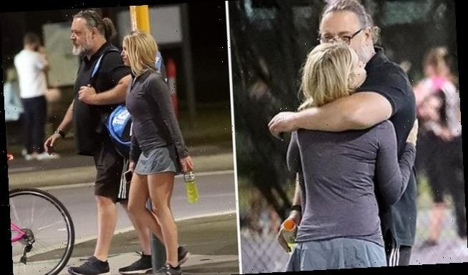 Russell Crowe finds comfort in the arms of friendBritney Theriot