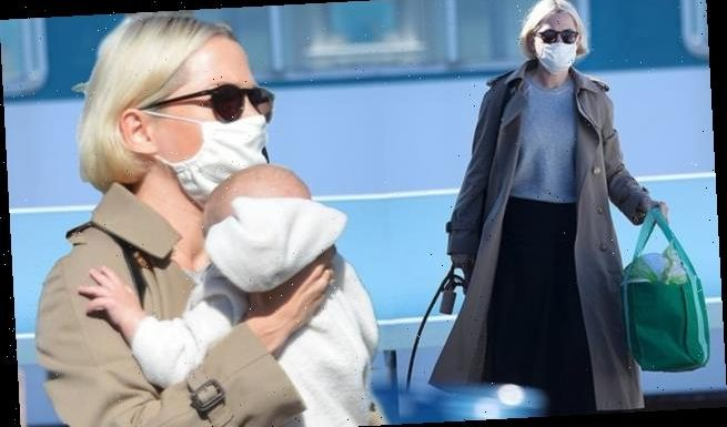 Michelle Williams makes her first appearance with baby number two