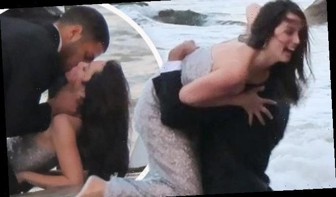 Ana gets swept into arms of male model during beach shoot for ad