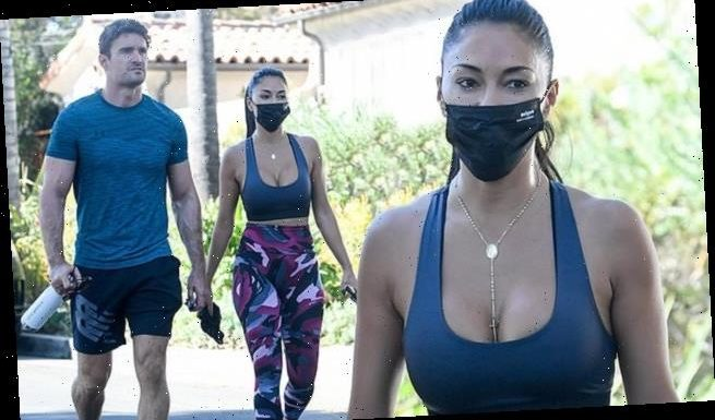Nicole Scherzinger leaves a work out with beau Thom Evans